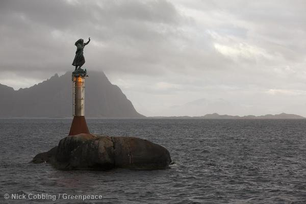 The statue of the Fisherman's Wife at the entrance of Svolvr Harbour in Norway. The statue waves goodbye to fishing boats heading out to sea and greets them as they return safely. Norway likes to give the impression that it is a responsible ocean nation.