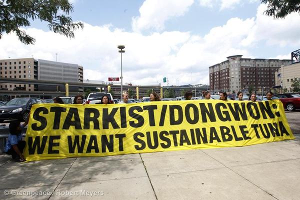 Greenpeace activists display banners outside the headquarters of StarKist Tuna calling on StarKist and parent company Dongwon to adopt sustainable fishing practices.