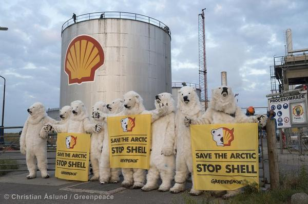 Greenpeace activists dressed as polar bears, protest at the Shell oil refinery in Fredericia, Denmark, to expose the company's plans to drill for oil in the fragile Arctic region.