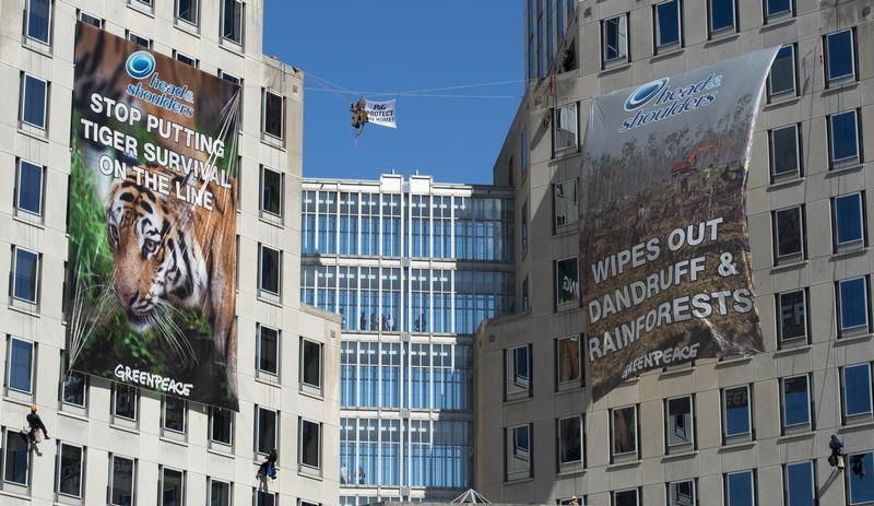 Deforestation banners on Procter & Gamble headquarters in Cincinnati