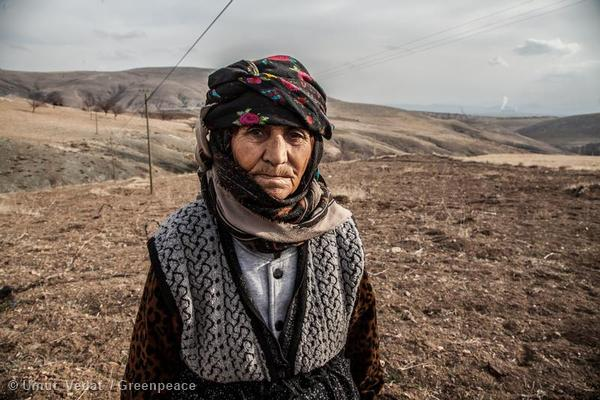 Woman near Afsin-Elbistan A and B Plants in Turkey. The vineyard owned by her family has dried out and is polluted from the ash and heavy metals produced by the power plant. Local people claim that the plants are responsible for serious health effects and that the ash produced dries up rivers and agricultural lands in the area.