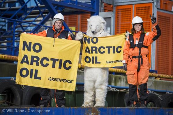 Five of the activists scaled the West Alpha rig and unfurled signs.