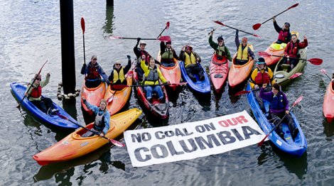 Concerned Oregonians and Washingtonians paddle in Bradbury Slough off the main stem of the Columbia River, near Mayger, Oregon, Oct. 20, 2012, to draw attention to the dangers of Ambre Energy's Morrow Pacific coal export proposal.