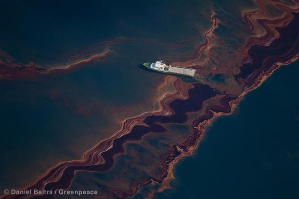 A view from an altitude of 3200 ft of the oil on the sea surface, originated by the leaking of the Deepwater Horizon wellhead disaster.