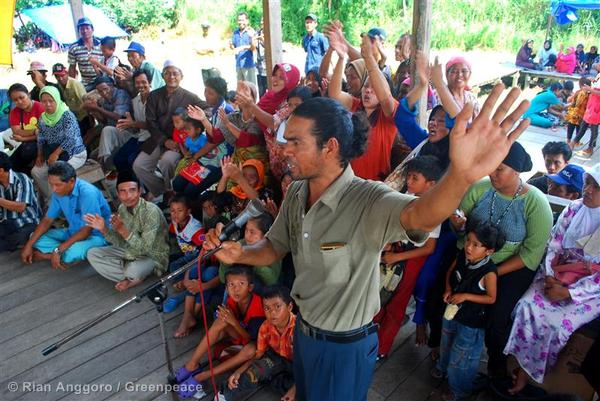 Villagers celebrating the re-opening of the Community Camp for Peatland Forest at Kampar Peninsula Forest.