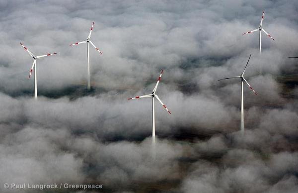 An aerial of Enercon wind turbines near Straussberg (Brandenburg) among clouds in the morning.
