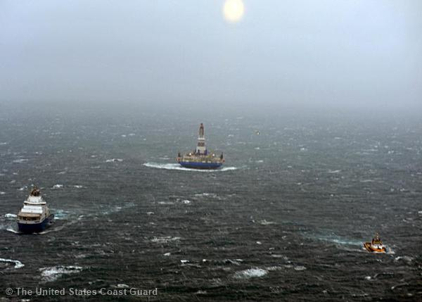 The tow vessel Aiviq (left) and the tug Alert tow the conical drilling unit Kulluk through rough seas southeast of Kodiak, Alaska, Monday, Dec. 31, 2012.