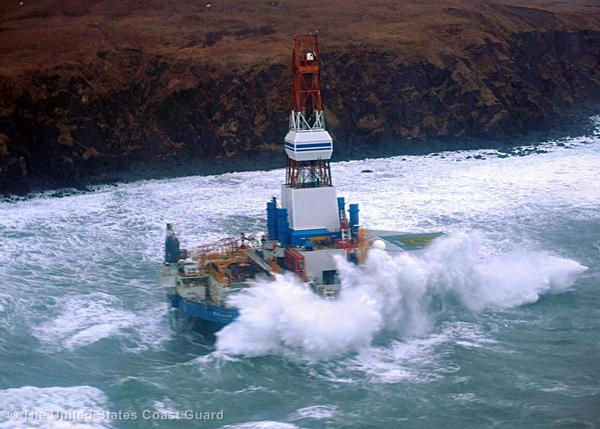 Waves crash over the conical drilling unit Kulluk where it sits aground on the southeast side of Sitkalidak Island, Alaska, January 1, 2013.