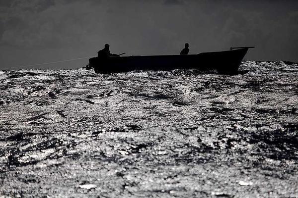 Artisanal fishermen working in their boat in Black Rivery Bay, Mauritius.