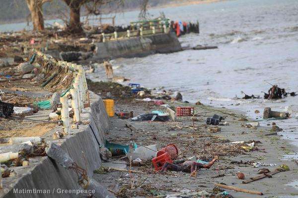 A dead body lies on the sea shore in Tacloban City after Super Typhoon Haiyan hit the area.