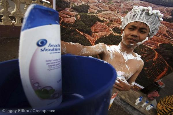 Volunteer joins a Day of Action to protect paradise in Padang, Riau, Indonesia