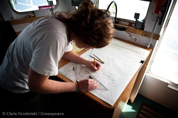 Anne Mie Roer Jensen, one of the Arctic30 activists, navigating on the Bridge of the Rainbow Warrior 3 during the hunt for the Mikhail Ulyanov.