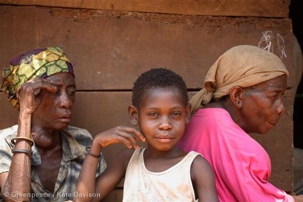A boy and two old women of a community of Baka people (pygmies) who live on the outskirts of Libongo, Cameroon.