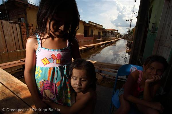 Children of the flooded Cacao Pereira village in the Brazilian Amazon.