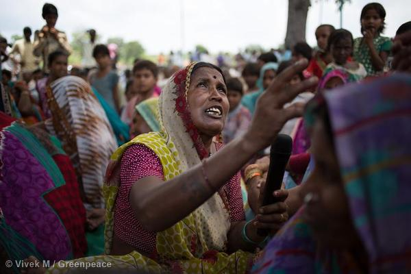 A woman speaks out for her forest at a public meeting against Essar in Mahan.