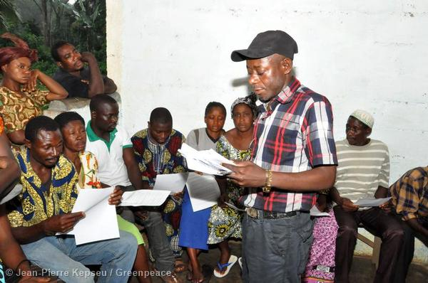 Achuo Fobia, of local NGO Nature Cameroon, addresses residents of the village of Ebanga in the countrys South West region, at a meeting being held in conjunction with Greenpeace.
