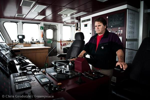 """Pete Willcox, captain and member of the """"Arctic 30"""" at the bridge of the Rainbow Warrior III."""