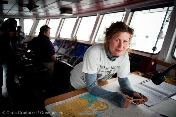 Anne Mie Roer Jensen, one of the Arctic 30 activists, navigating on the bridge of the Rainbow Warrior.