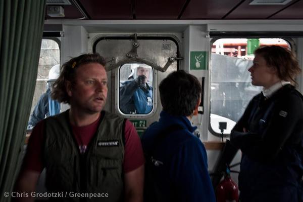 Police board the Greenpeace ship Rainbow Warrior III to arrest activists.