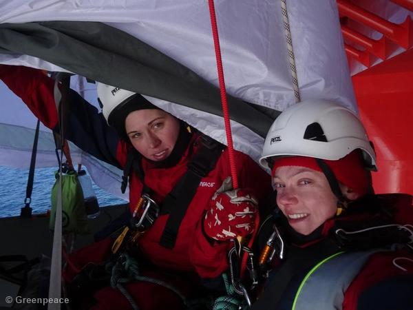 Sini Saarela and Rosa Gierens of Finland bedding down while suspended on a Porta-ledge from the rig.