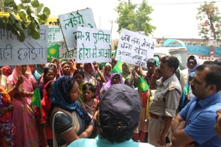 Priya Pilal leads villagers in a nonviolent confrontation of authorities at a rally this week in Mahan.