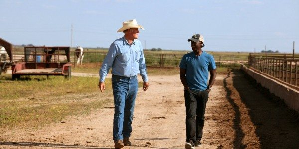 Don Cheadle talks to a farmer suffering drought in Plainview, TX.