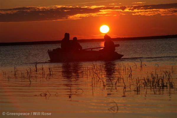 Local People on Boat in Yamal Peninsula