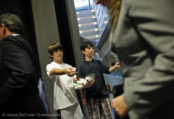 Drew Walker, 12, left, and Michael Mangione, 11, both of Towson, Maryland, hand out asthma inhalers labeled with the slogan 'Coal takes my breath away' to delegates as they leave the Coal USA Conference.