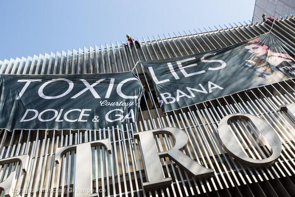 Greenpeace activists scale the Metropol Theatre in Milan, Italy and display a banner reading - 'TOXIC LIES, Courtesy of Dolce & Gabbana.'.