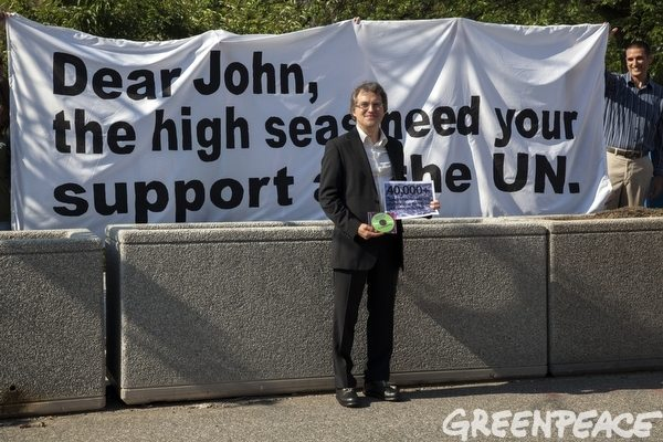 Daniel Mittler holds a disk containing over 40,000 signatures urging Secretary Kerry to support high seas biodiversity protection.