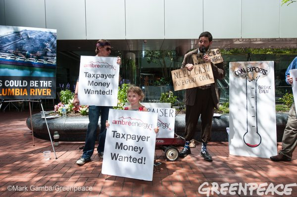 Activist hold mock fundraiser for struggling coal company Ambre Energy outside Portland, OR headquarters.