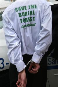 Cuffed Activist at Kimberly-Clark Office