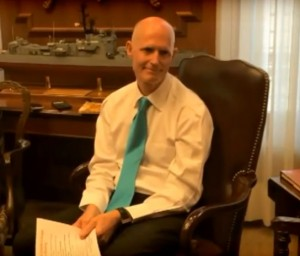 Rick Scott gets schooled on climate science, doesn't listen.