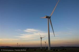 Sunrise behind Wind Turbine