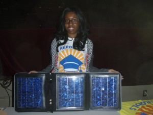 Kearra, a student at Southern High for Energy & Sustainability in Durham, holds up solar a demonstration solar panel to other students