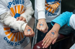 Kids show off their temporary tattoos with the Repower Our Schools logo!