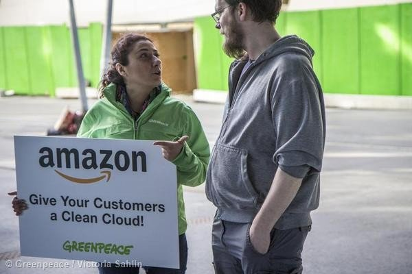 """During the Amazon.com Inc. summit in Stockholm, Greenpeace Sweden asks AWS customers to demand the company """"clean its cloud"""" and go 100% renewable."""