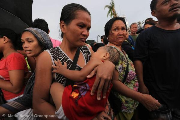 Residents of Tacloban City await airlift after Typhoon Haiyan devastated their city.
