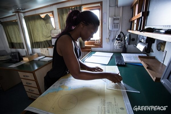 Tulepka, a crew member of the Espy, reviews a map of the Gulf of California in order to chart the best route for the ship. July 19, 2015.