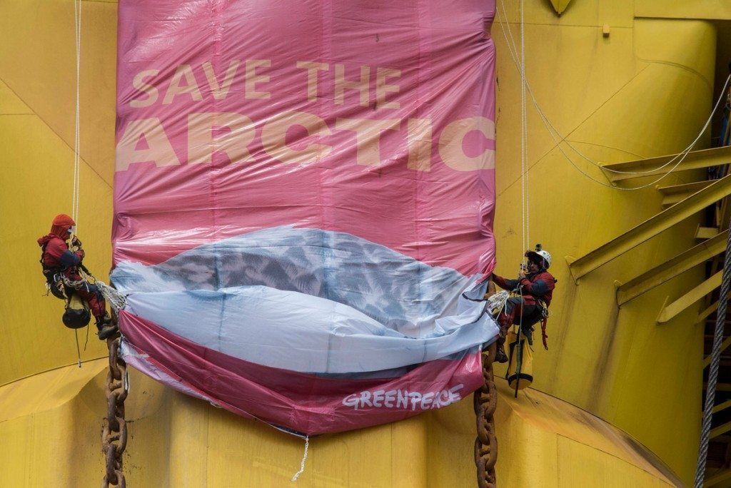 Greenpeace activists have rigged a 'Save the Arctic' banner showing an Arctic Owl and containing the signatures of millions of supporters on a leg of the Polar Pioneer oil rig in the Pacific Ocean. Six Greenpeace climbers have intercepted an Arctic-bound Shell oil rig in the middle of the Pacific Ocean, 750 miles north-west of Hawaii and have scaled the 38,000 tonne platform. The six, from the USA, Germany, New Zealand, Australia, Sweden and Austria, sped towards the Polar Pioneer, which Shell intends to use to drill for oil in the Chukchi Sea, in inflatable boats launched from the Greenpeace ship Esperanza.