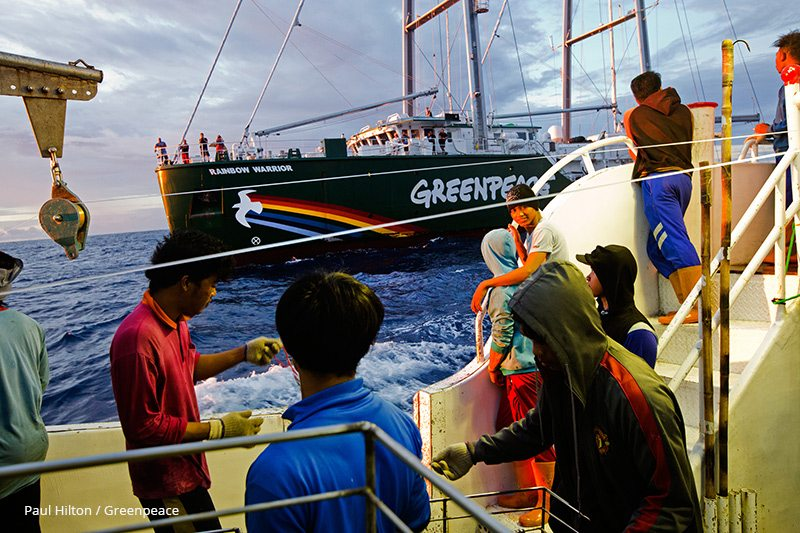 Crew of illegal fishing vessel Shuen De Ching No.888 look on as the Rainbow Warrior pulls up alongside.