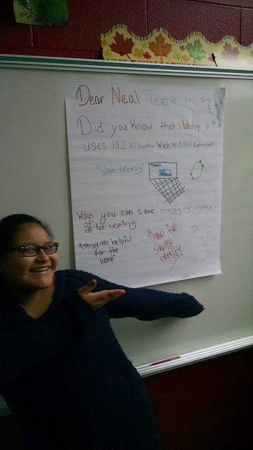 This 7th grader is excited to show off her poster, reflecting her calculations from the energy audit at her school. Reed Fagan / DPS