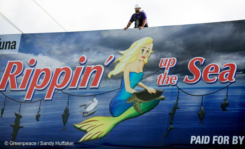 Workers install Chicken of the Sea protest billboard