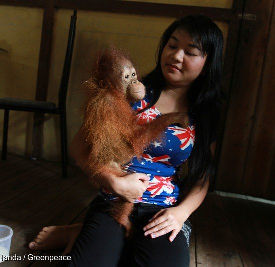 22-year-old Ayu Nurisaputra holds eight-month-old Otan.