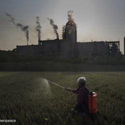 Spraying Crops in front of Steel Plant in Jiangsu