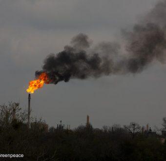Gas flares hydrofracking installation in Texas.