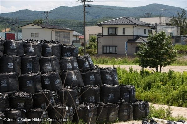 Iitate district, northwest of the Fukushima Daiichi nuclear plant, was heavily contaminated by the March 2011 accident. Here, bags of radioactive waste pile up nearby abandoned homes (July 2015).