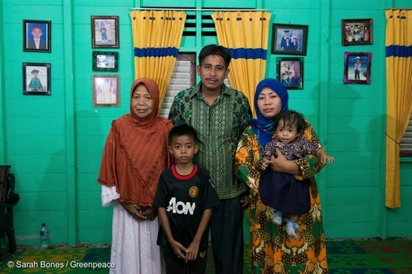 Pak Manan with his family at his home in Sungai Tohor.