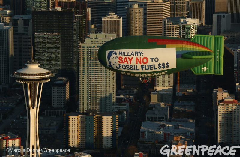 The Greenpeace A.E. Bates thermal airship flies over Seattle, Washington and the Space Needle on March 25, 2016 urging Hillary Clinton to reject fossil fuel money in her campaign. The Democratic caucuses are March 26, 2016. Photo by Marcus Donner/Greenpeace