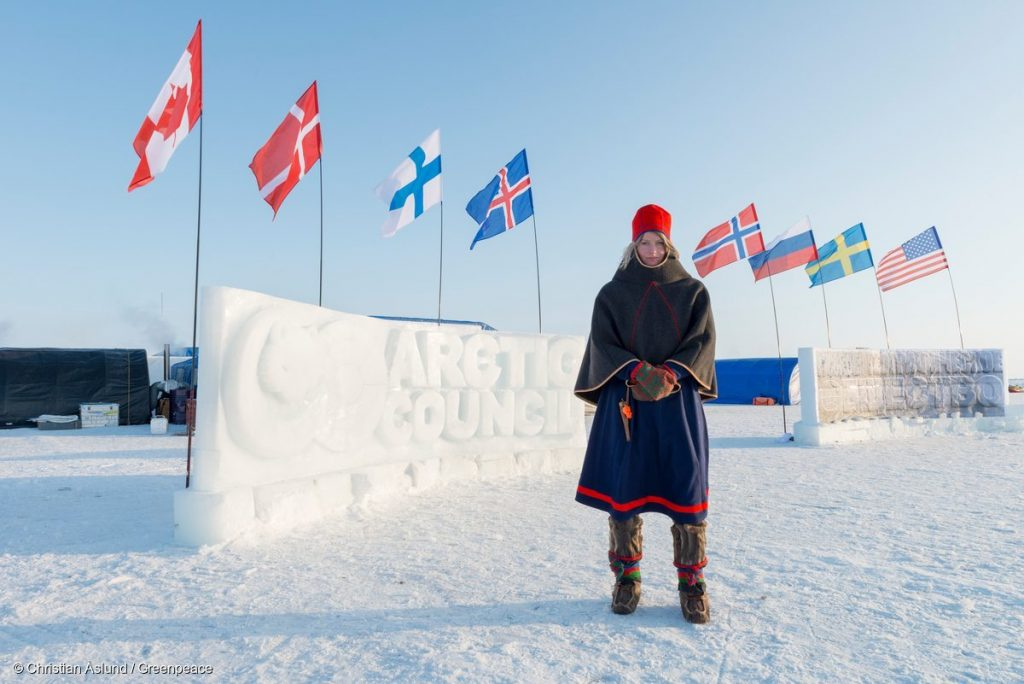 Josefina Skerk, from Sweden, in traditional Sami dress at Barneo base in the high Arctic. She is one of the four young ambassadors about to trek to the North Pole. They are carrying with them a time capsule containing 2.7 million names of supporters who wish to protect the Arctic. They plan to lower the capsule and a 'flag for the future' to the seabed beneath the North Pole.
